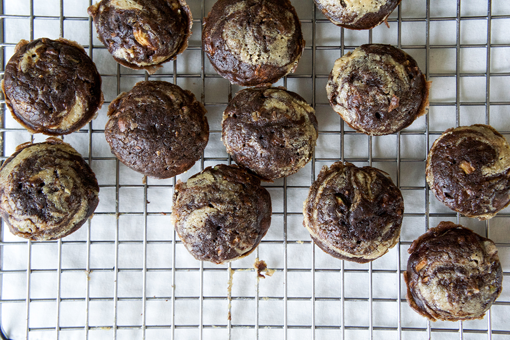 chocolate zucchini muffins on a cooling rack