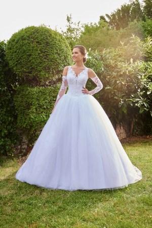 robe de mariée volumineuse en tulle pailleté et dentelle perlé
