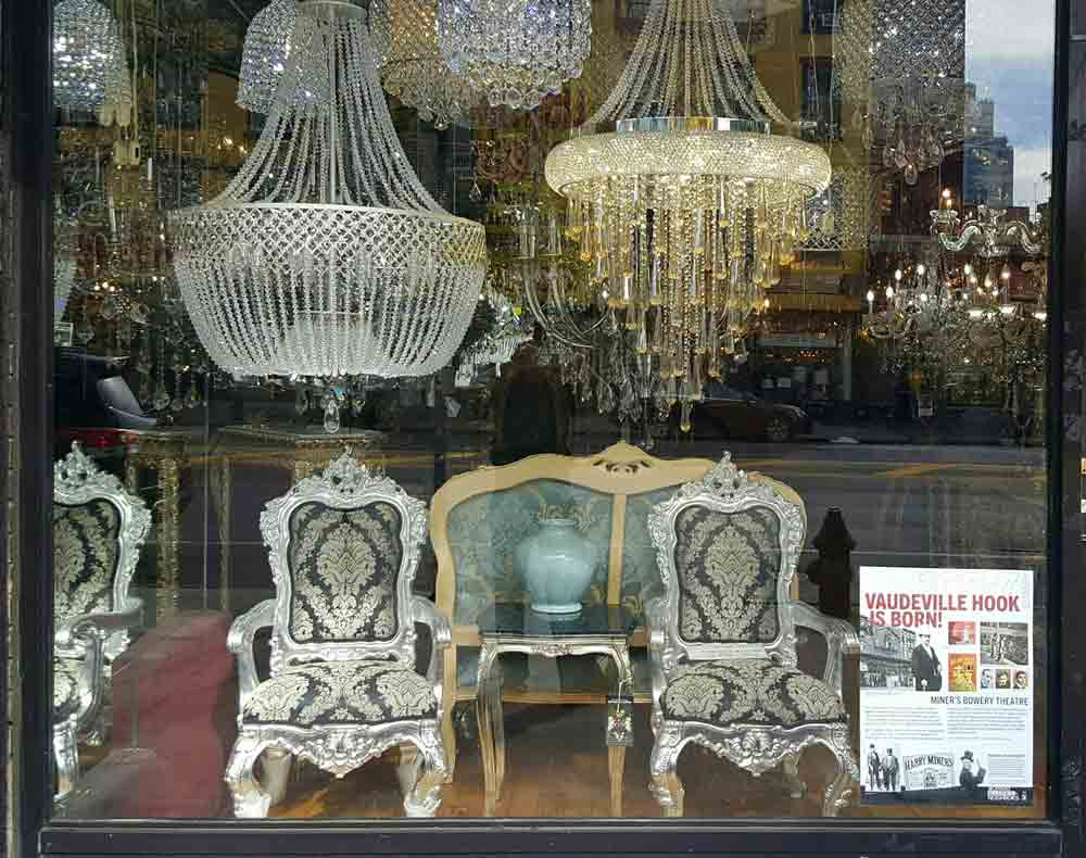 Mandarin Dynasty Chandelier storefront with poster for the Birthplace of the Vaudeville Hook
