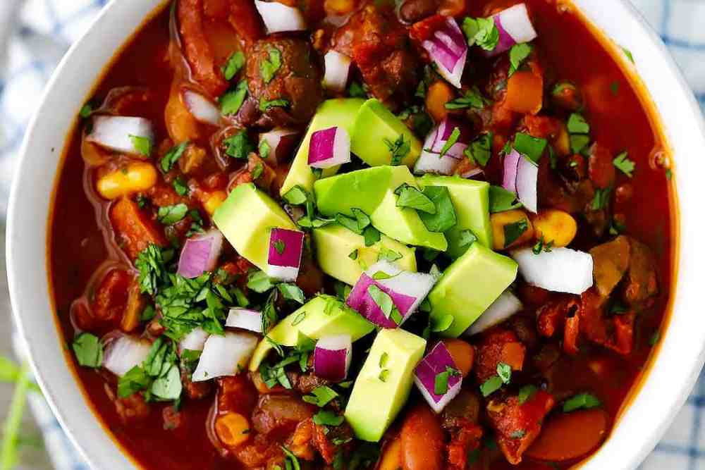 Smoky Vegetarian Chili | Filled with mushrooms and beans, this vegan chili is delicious, filling, and nutrient-packed. But what really makes this chili really stand on its own is the secret spice combination that makes it smoky, velvety, and spicy.