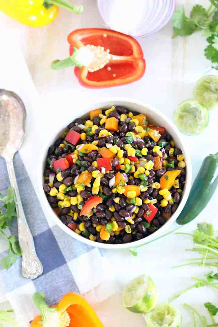 This Black Bean and Corn Salad is the perfect make-ahead side since it's served cold and requires NO cooking! It's vegetarian and vegan friendly, and literally all you do is mix some stuff in a bowl and call it a day. Serve as a side, on top of greens as a main course salad, or use as a salsa with tortilla chips!