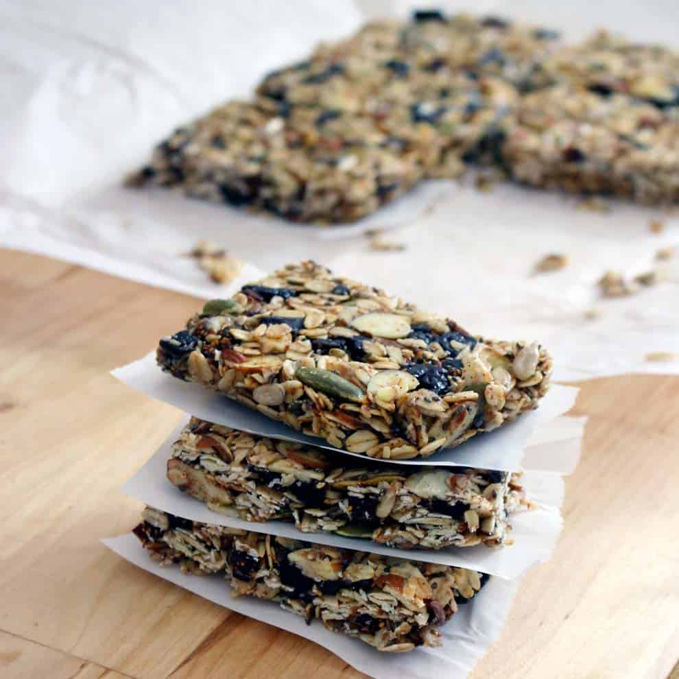 A no-bake, easy chewy granola bar recipe that comes out perfect every time with coconut oil and no refined sugar! Add any nuts, seeds, dried fruit, and spices you want. A perfect back to school snack!