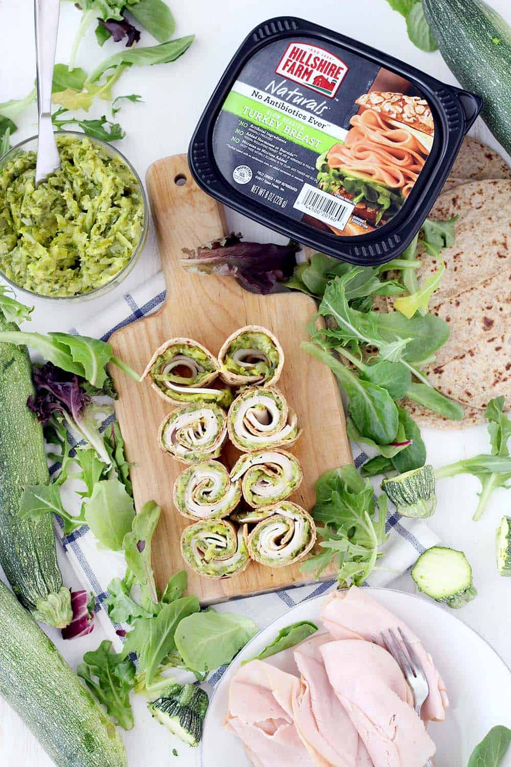 These Turkey Roll-Ups are spread with yummy, veggie-packed Zucchini Butter instead of mayo for an easy meal-prep sandwich for lunches all week long! Great for back-to-school and super kid friendly. Use any leftover zucchini butter in an omelette, as a dip, or to stuff chicken breasts.