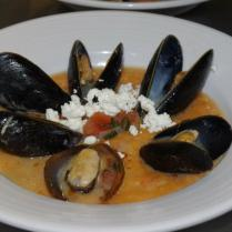 Trahana krema with ouzo steamed mussels, hot peper oil and crumbled feta