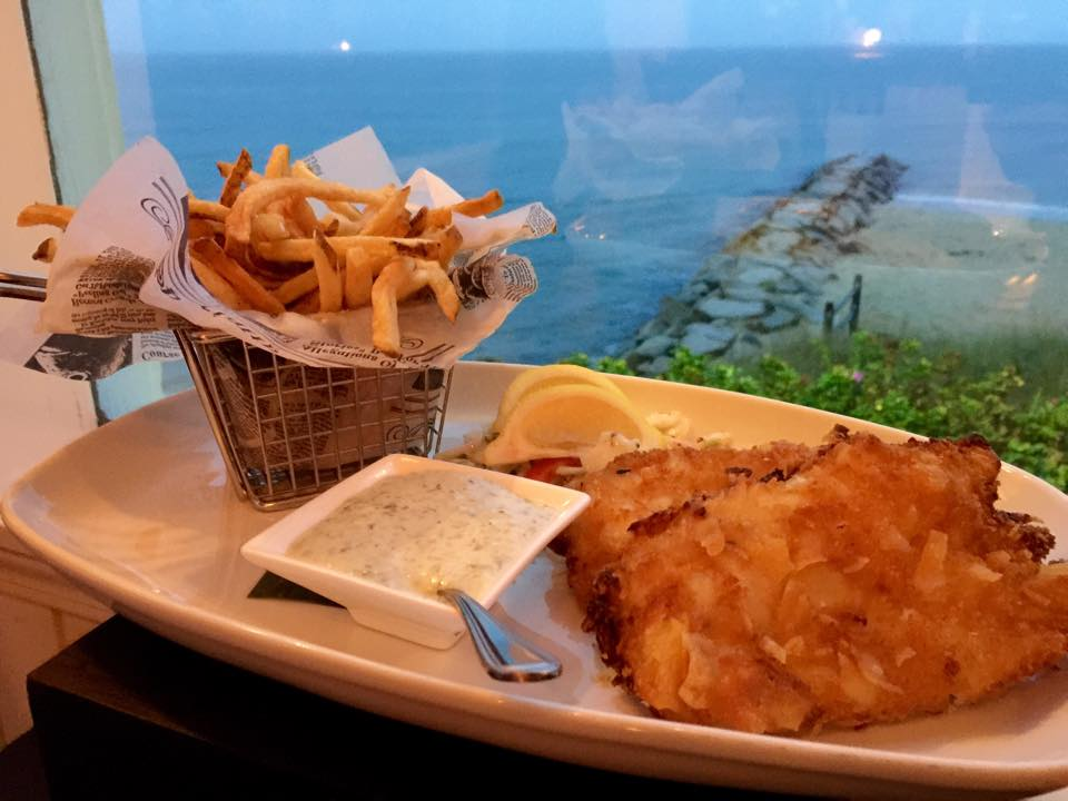 The potato chip encrusted fish and chips is a popular dish to enjoy seaside.