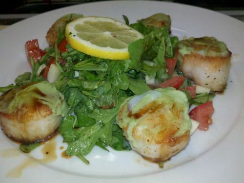 Wasabi encrusted scallops on a salad of greens is a crowd pleaser.