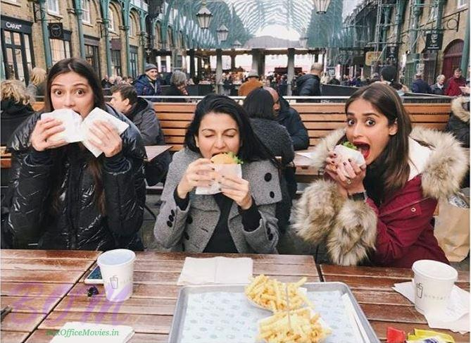 Athiya Shetty stuffing the face with Ileana Dcruz on a freezing Monday