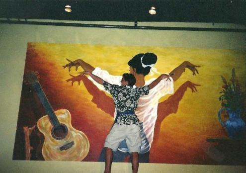 artist mimicking a mural pose
