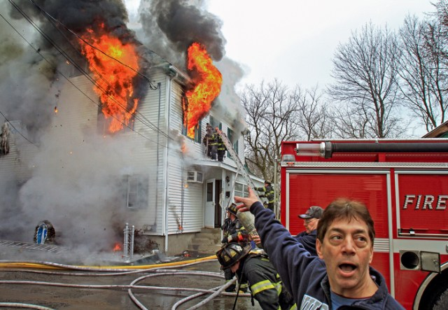 Newton firefighters work at a 3-alarm fire at 11 Morgan PL. this afternoon, March 2, 2012.