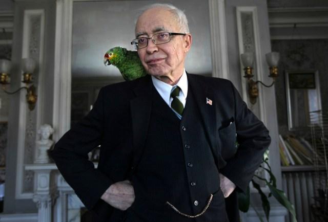 Arlington, MA - 3-8-12 - John Lorimer Worden III at his home with his parrot Tosca.