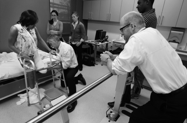 Paul Martino, of United Prosthetics, makes a plaster cast of what remains of Mery Daniel's left leg, as her physician, Dr. David Crandell, right, watches at the Spaulding Rehabilitation Hospital in Boston, Wednesday, May 29, 2013. Crandell, a physiatrist at Spaulding, has treated fifteen of the sixteen marathon amputees.  Behind Crandell is Mery's husband, Richardson Daniel.