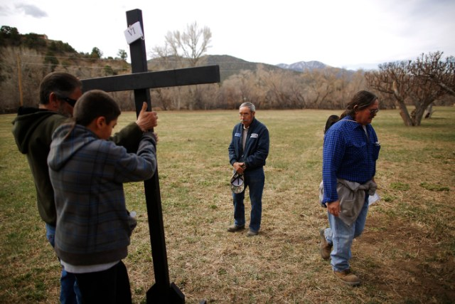 Volunteers take down a cross following a Stations of the Cross stop during a Good Friday pilgrimage in Talpa, New Mexico March 29, 2013.  Several hundred followers of the Catholic Church walked a pilgrimage celebrating the Stations of the Cross from the San Francisco de Asis Catholic Church, through Ranchos de Taos and the remote village Talpa,  New Mexico.