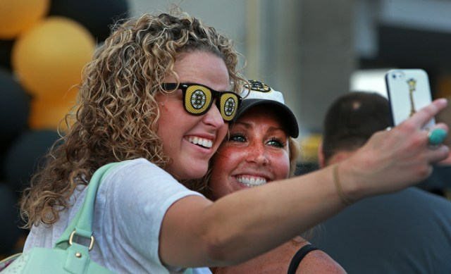 Lauren Palmacci (left) and her sister Lia Palmacci, season ticket holders from Groton, MA take a picture of themselves outside the Garden before the game.  The Boston Bruins hosted the Chicago Blackhawks for Game Six of the Stanley Cup Finals at the TD Garden.