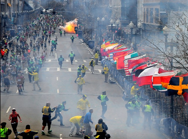BOSTON, MA. 04/ 15 /13:  The second bomb explodes as runners approach the finish line at the 117th Boston Marathon.