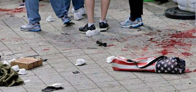 Blood from victims covers the sidewalk on Boylston Street, at the site of an explosion during the 2013 Boston Marathon in Boston.