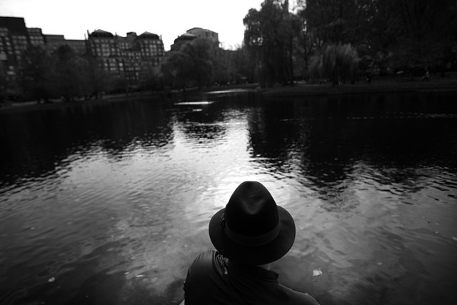 Boston, MA., 11/15/13,  Grant Roden sat at the edge of the pond at sunset in the Public Garden.
