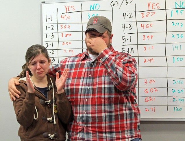 ( Revere, MA,02/25/14)        Joseph Catricala breaks down in tears with his wife Meagan in front of the tote board holding the results of their lose as the anti casino forces gather to watch the results at the First Congregational Church in Revere.     Tuesday,  February  25, 2014.