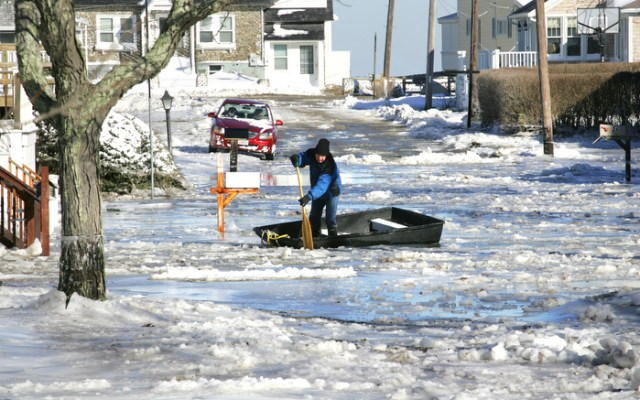 Areas of Scituate remain inundated with flooding after a two day Nor'easter dumped over a foot of snow and delivered frigid temperatures to the region, Saturday, Jan. 4, 2014.