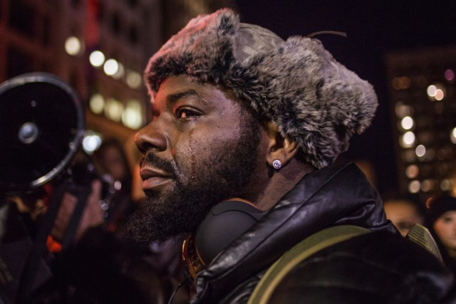 December 4, 2014 – A man reacts during a protest on the Boston Common after the grand jury in Staten Island, N.Y., decided not to indict Officer Daniel Panteleo in the death of Eric Garner.
