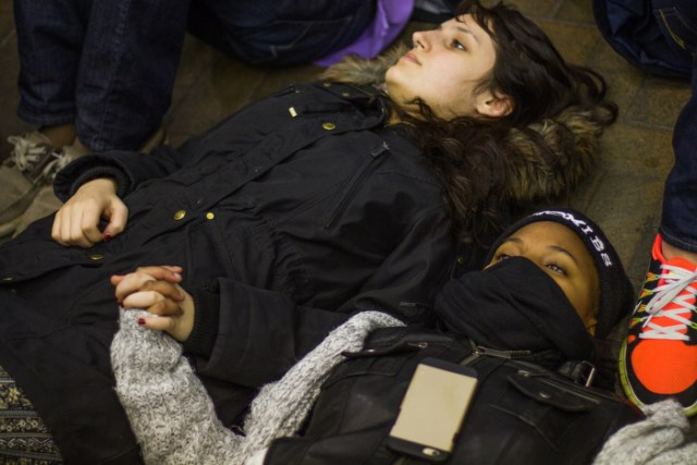"December 4, 2014 – Protestors lie on the ground in a ""die-in"" demonstration at Park Street station in Boston, Mass., after the grand jury in Staten Island, N.Y., decided not to indict Officer Wilson."