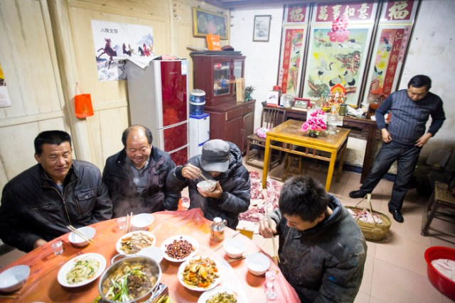 The raw pork was left to cool off on the floor in the living room while men enjoy dinner, January 5,
