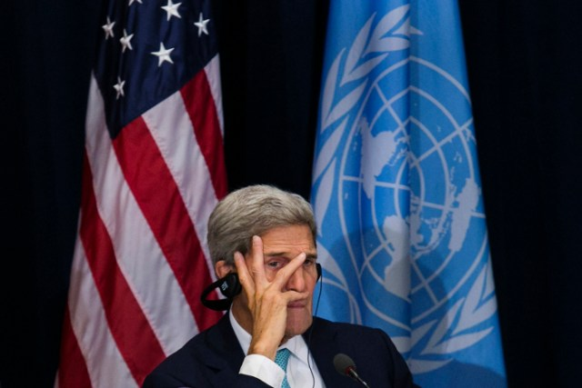United States Secretary of State John Kerry listens during a meeting with Afghanistan CEO Abdullah Abdullah, Afghanistan Foreign Minister Salahuddin Rabbani, and China Foreign Minister Wang Yi at the Palace Hotel on September 26, 2015, during the United Nations General Assembly in New York.