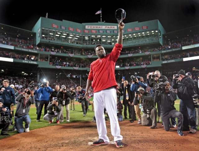 Boston Red Sox designated hitter David Ortiz raises his hat in an impromptu goodbye to his fans after his last regular season game at Fenway Park on Monday, October 10, 2016.