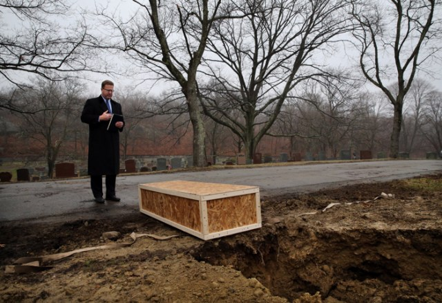 """Robert Lawler says a prayer over the casket of Jeanne Kirby in the """"City Poor Lot"""" at Fairview Cemetery in Boston, MA. Lawler said Jeanne Kirby was homeless and she died on the streets in Boston on October 20, 2015. She was 39 years old. Her body remained at the medical examiners until Lawler buried her on March 25, 2016. The state medical examiner's office, concerned that it could run out of room to store corpses, has nearly doubled the amount of money it offers funeral homes to bury unclaimed bodies. The office must hold unclaimed bodies until a funeral home can be found that is willing to bury them, but that process has been increasingly delayed, the medical examiner's office said. The $1,100 fee that the state used to offer to funeral homes to perform the burials was insufficient. Just three funeral homes had handled such burials recently, and most were done by Lawler, the office said."""