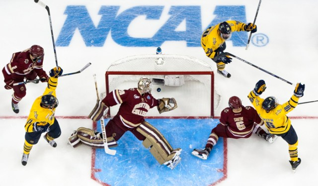 Landon Smith #16 of the Quinnipiac University Bobcats scores a goal against Thatcher Demko #30 of the Boston College Eagles as his teammates Tim Clifton #11 and Travis St. Denis #26 celebrate during the Bobcats 3-2 victory in the 2016 NCAA Division I Men's Hockey Frozen Four Championship Semifinal at the Amaile Arena on April 7, 2016 in Tampa, Florida.