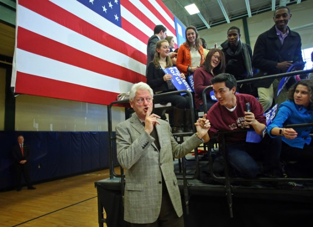Former President Bill Clinton shushes people in the crowd as they call out to him while his wife, Democratic candidate for President Hillary Clinton speaks at a town hall event in Nashua, NH  The former President introduced his wife before stepping off the stage.
