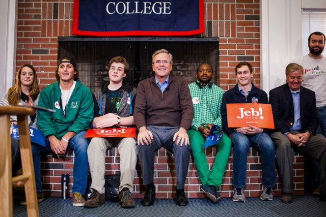 Republican presidential candidate Jeb Bush (center) waits to be introduced at a campaign event at New England College in Henniker on Tuesday, Feb. 2, 2016. Sen. Lindsey Graham (right) attended in support of the former Florida governor.