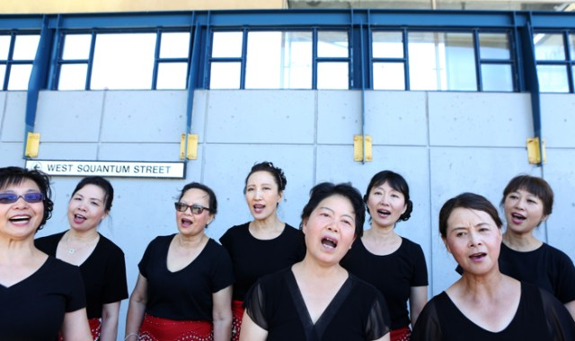 Members of the Huaxia Chinese Cultural Association of Malden rehearse in the shade prior to performing at the Quincy August Moon Festival, Sunday, August 21, 2016.