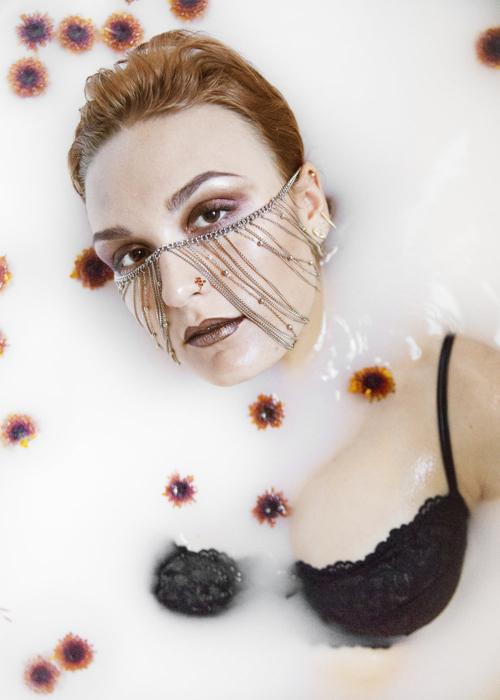 Nov. 13, 2016 – Samantha Morse, 21, of Boston, models in a bathtub composed of half milk, half water for a fall 2016 fashion spread.