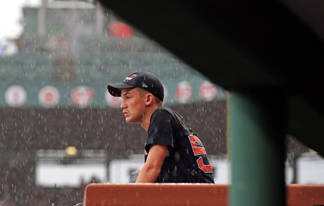 A fan waits out the rain delay before the Boston Red Sox vs. Toronto Blue Jays MLB game at Fenway Park.
