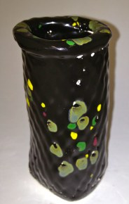 pewter, green yellow & maroon crystals on low-fire black glaze