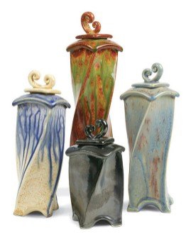 These vessels were glazed with AMACO® glazes MF-20 Dark Blue over LT-113 Sand (left), MF-40 Dark Green over LG-36 Freckled Brown (back), ST-25 Blue-Gray over LT-3 Old Pewter (front), and LT-161 Tiger Eye over ST-23 Light Blue (right). (photo courtesy AMACO)