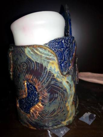 Julie Sieving - Amaco Blue Sapphire used with other pc glazes. Red clay cone 6.