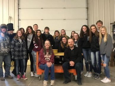 With Joe Summers and his class when they toured our building and were then presented with a wheel we donated to them
