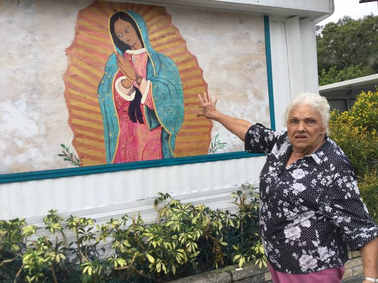 Attorneys representing Tropical Palms mobile home park in Bradenton are following through with a threat of legal action if resident Millie Francis continues to refuse to remove a painting of the Virgin Mary in front of her mobile home.