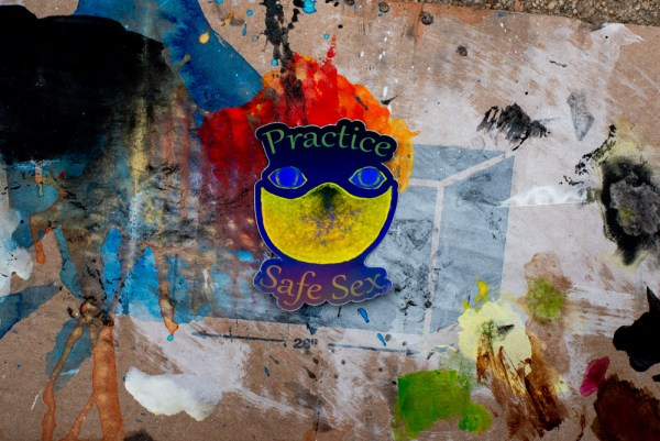 a practice makes perfect sticker by bradley flora with a background that is painted cardboard