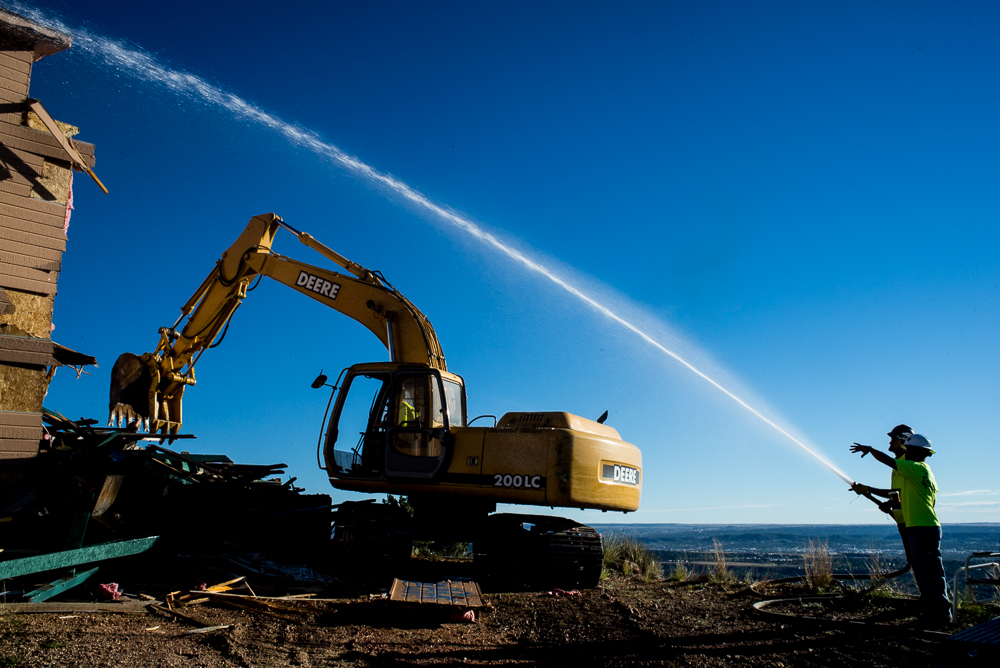 A photo of an earthmove demoltion and waterspraying to prevent sparks