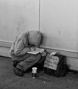 Homeless Man Reading the Bilble