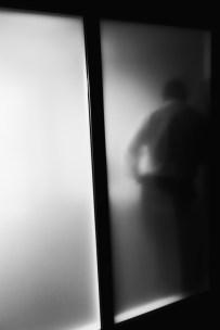 Sept 12: Man Behind Glass