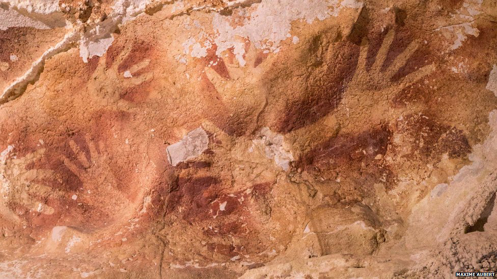 hand stencils dated in caves in indonesia