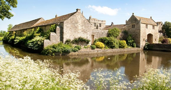 The moat at Markenfield Hall Yorkshire Dales England UK by Markenfield Hall