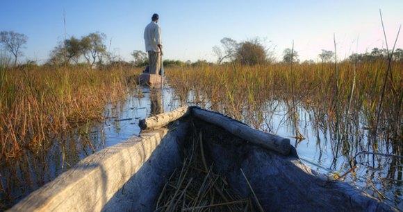 Travel between the beautiful islands and waters of the Okavango Delta ©  PlusONE, Shutterstock