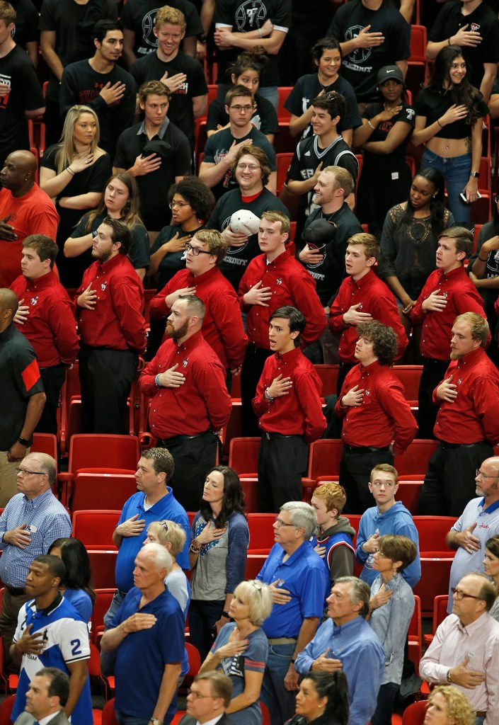 Texas Tech and Kansas fans stand during the national anthem before an NCAA basketball game against Kansas, Saturday, Feb. 11, 2017, in Lubbock, Texas. (AP Photo/Brad Tollefson)