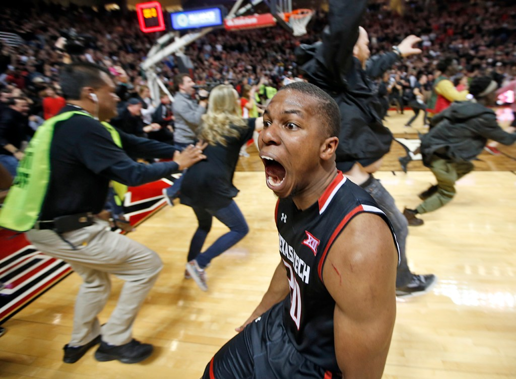 Texas Tech's Toddrick Gotcher runs toward the fans to celebrate after an NCAA basketball game on Wednesday, Feb. 17, 2016 at United Supermarkets Arena in Lubbock, Texas. Texas Tech beat Oklahoma 65-63.