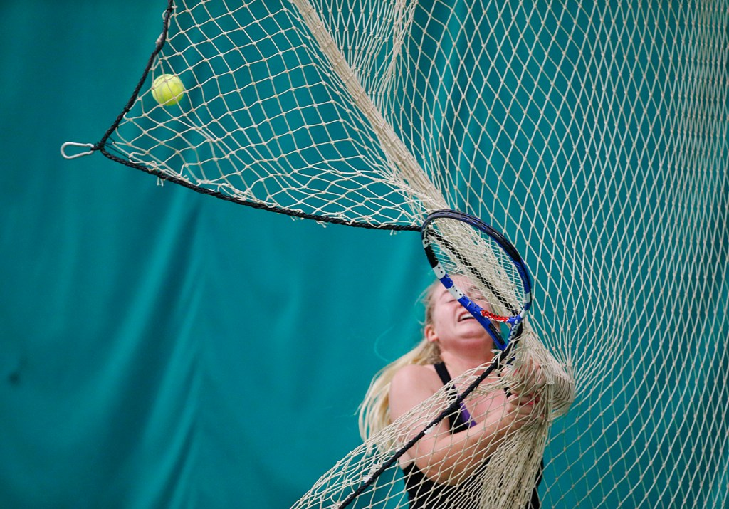 Lubbock High's Cherokee Hernandez runs into a net while returning the ball during her doubles match with Peyton Trebisky on Tuesday, April 19, 2016, at Lubbock Country Club in Lubbock, Texas. Hernandez and Trebisky won their match in the UIL 5A Region 1 Championship to compete in the state tournament.