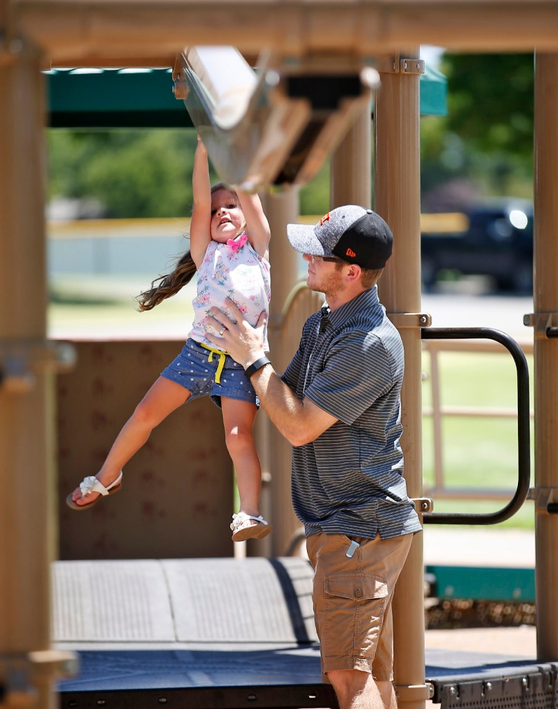 Kale Ferguson, from Lamesa, pushes his daughter Reese on a zip line ride Thursday, July 7, 2016, at Maxey Park in Lubbock, Texas. Lubbock broke a record high temperature for July 7 with 108, beating the previous record of 103 from 1998.